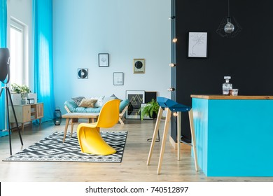 Eclectic living room interior with bar in black and blue