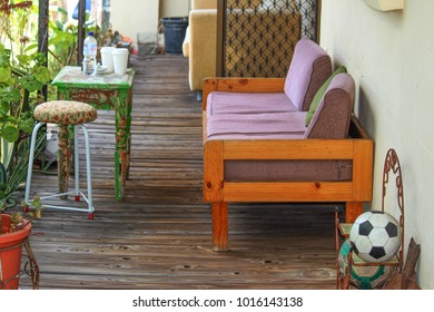 Eclectic mix of furniture and decor on a victorian front veranda