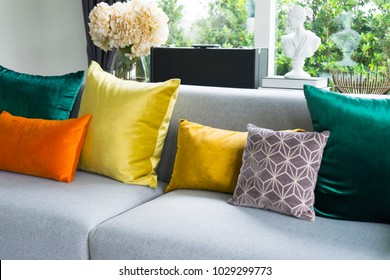 Eclectic style of living room with grey sofa and colorful pillows