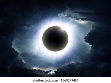 Eclipse of the Sun in the Abstract Dark Storm Clouds