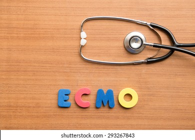 ECMO (extracorporeal membrane oxygenation) colorful word with stethoscope on the wooden background