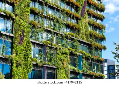 Eco architecture. Green skyscraper with hydroponic plants on the facade. Ecology and green living in city, urban environment concept. Park in the sky, One central park building, Sydney, Australia