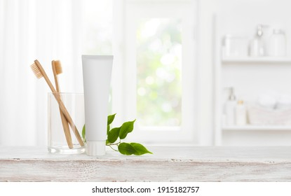 Eco bamboo toothbrushes and toothpaste tube mockup with copy space