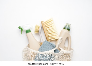 Eco brushes and rag on white background. Flat lay eco cleaning products. Cleaner concept