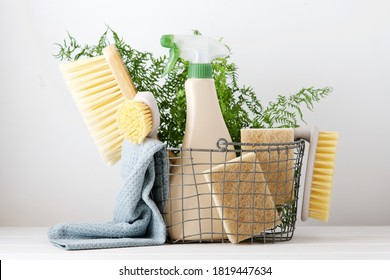 Eco brushes, sponges and rag in cleaning basket. Cleaner concept on white background
