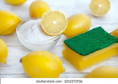 Eco cleaners baking soda, lemons and sponge on the table