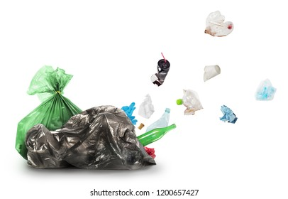 Eco concept. Out of a garbage bag, trash takes off, isolated on a white background. The concept of recycling garbage.