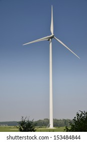 eco energy produced by modern windmill in a rural landscape