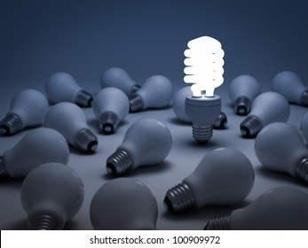 Eco energy saving light bulb, one glowing compact fluorescent light bulb standing out from the unlit incandescent light bulbs or Individuality concept