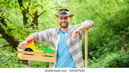 Eco farm worker. Harvest. sexy farmer hold shovel and box with pot. farming and agriculture. I love to work with plant. Garden equipment. happy earth day. Eco living. muscular ranch man in cowboy hat.