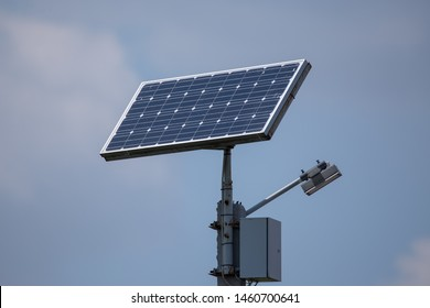 Eco friendly Autonomous Led street light projector with solar panel for daytime charging.