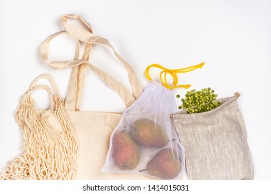 Eco friendly bags for shopping - linen, burlap, mesh bag. Pairs and green lentil in natural linen and burlap bags. Zero waste background