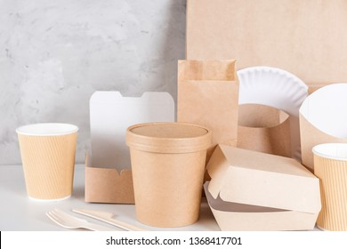 Eco friendly disposable tableware. Paper cups, dishes, bag, fast food containers and bamboo wooden cutlery. recycling concept