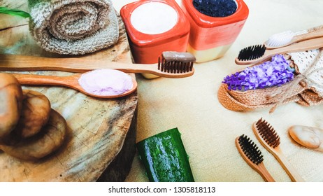 Eco friendly natural bamboo toothbrush place on wooden plates and toothpaste made from salt,charcoal and Aloe,concept reduce use plastic for Sustainable health