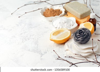 Eco friendly natural cleaning tools and products, metal brush, soap, mustard, soda, lemon, essential oils. Plastic free. Flat lay, top view