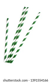 Eco friendly paper straws in green and white stripes. Isolated on white background in vertical format.