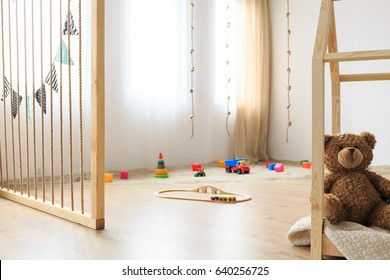 Eco friendly play area in natural wooden kids bedroom