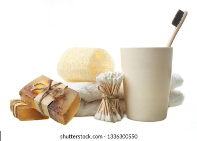 eco friendly products: handmade soap, towel sponge luffa , bamboo ear sticks and toothbrush isolated on white. Concept zero waste.