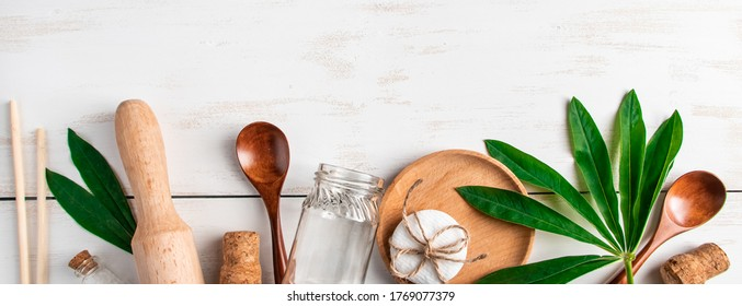 Eco friendly recyclable products on white wooden background. Plastic-free kitchen accessories. Banner format