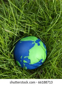 Eco Friendly, Sustainability Earth Day concept: Green and Blue Globe with grass