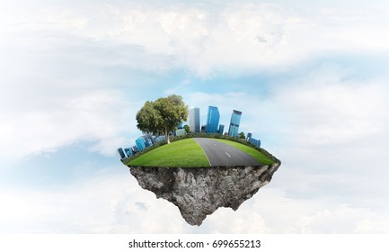 Eco green concept with cityscape on island floating in sky