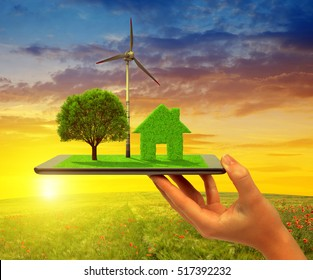 Eco land on tablet computer at sunset. Concept of environmental protection.