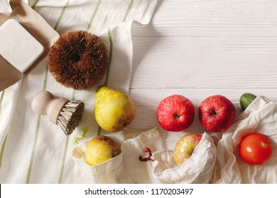 eco natural bags with fruits and coconut soap and brushes, eco friendly flat lay. sustainable lifestyle concept. zero waste food shopping. plastic free items. reuse, reduce,