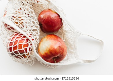 Eco packs. Eco bag with apples on white background. Purchase without harm to nature in anti-plastic bags. Zero Waste. Copy space for text