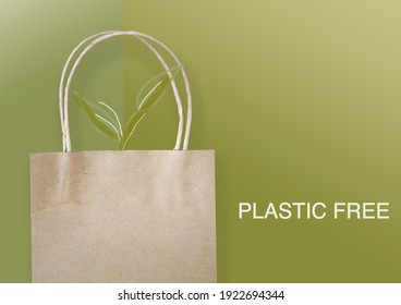 Eco paper bag with drawing plants on green background with wording plastic free