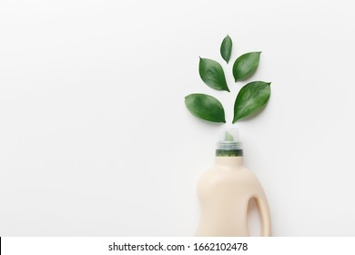 Eco style cleaning concept. Bottle with removing dirt detergent for everyday cleaning on white background, copy space