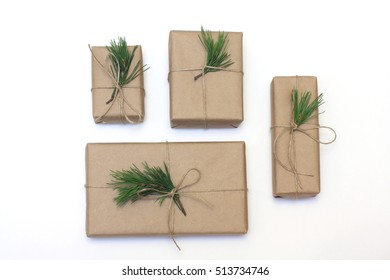 Eco style gift wrapping. Composition with gift boxes decorated with pine branches. Top view, flat lay