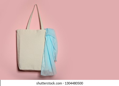 Eco tote bag with scarf hanging on color wall. Space for design