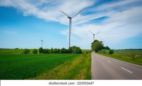 Eco Wind turbines farm and road in Poland
