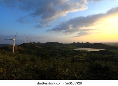 Eco-environmentally friendly power generation of power turbines of green energy on the top of the hill of dusk