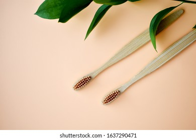 Eco-friendly bamboo tooth brush. Zero waste set on light beige natural background. Flat lay. Top view. Copy space.