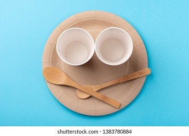 Eco-friendly biodegradable paper dishes on a blue background
