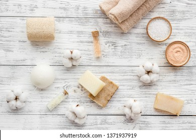 Eco-friendly cosmetics and zero waste set for spa on white wooden background top view