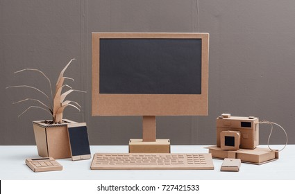 Eco-friendly creative office items and computer made from recycled cardboard, crafts and ecology concept