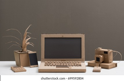 Eco-friendly creative office items and laptop made from recycled cardboard, crafts and ecology concept