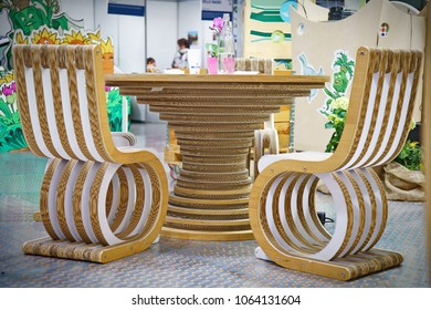 Eco-friendly creative office table and chairs made from recycled cardboard, crafts and ecology concept. Milan, Italy - April 2018