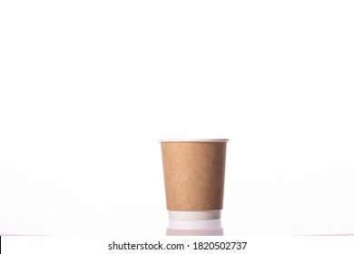 Eco-friendly disposable brown kraft paper cup isolated on white background. Coffee to go, takeaway hot drinks, cafe, restaurant, Recycling, tableware concept, mockup template. Copy space