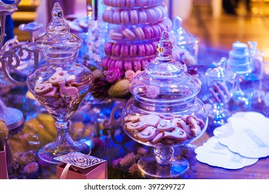 eco-friendly French makarons cake on the table. With purple lighting