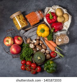 Eco-friendly lifestyle and shopping, zero waste, healthy organic vegetables and food in reusable cotton bag and glass jars, from farmer's market