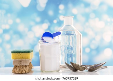 Eco-friendly natural cleaners baking soda, lemon and cloth on a blue background,