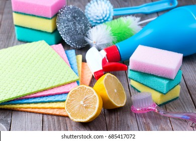 Eco-friendly natural cleaners, lemon and cloth on wooden table