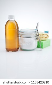 Eco-friendly natural cleaners. Vinegar, baking soda on white background. Homemade green cleaning.