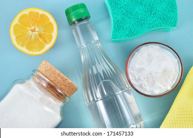 Eco-friendly natural cleaners. Vinegar, baking soda, salt, lemon and cloth. Homemade green cleaning.