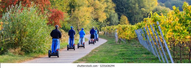 eco-friendly Segway scooters travel tour in Vineyards Palatinate region, German Wine Road, Rhineland-Palatinate, Germany, banner