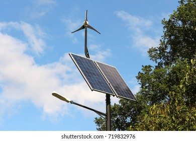 Eco-friendly street lamp with solar panels and a wind turbine