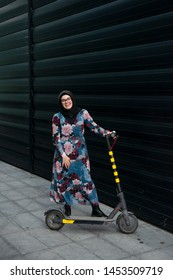 Eco-friendly transportation in a big city for a muslim woman with a hijab